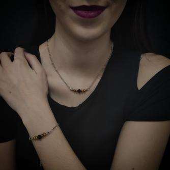 Unikatni komplet od kirurškog čelika, srebrna boja lančića sa crnim i zlatnim Swarovski perlama.